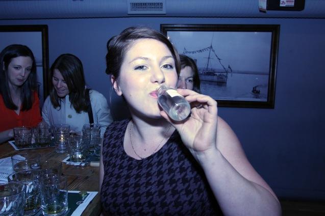 Kelly Marion drinking grain whiskey